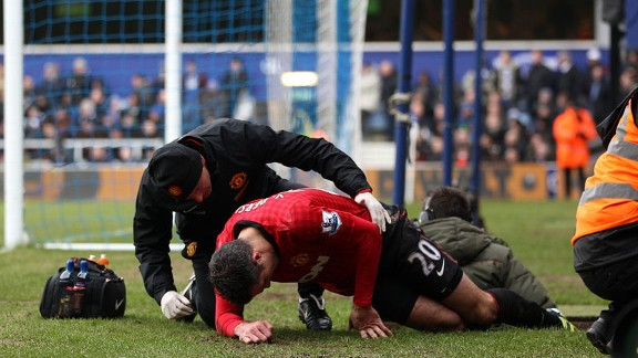 Robin van Persie receives treatment on an injury against QPR