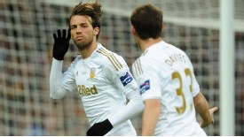 Michu celebrates Swansea's second goal against Bradford in the Capital One Cup final at Wembley