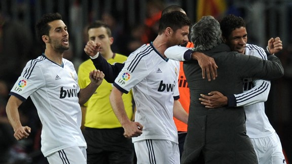 Raphael Varane celebrates with Jose Mourinho after netting Real Madrid's third