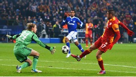 Burak Yilmaz lifts the ball over Timo Hildebrand for Galatasaray's second goal at Schalke