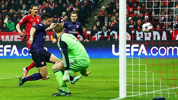 Olivier Giroud finishes from close range to give Arsenal the early lead at Bayern Munich