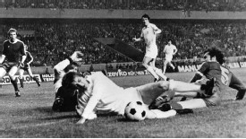 Bayern Munich's Franz Beckenbauer tackles Leeds United's Alan Clarke as the German side go on to win the 1975 European Cup Final in Paris.