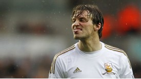 Michu reacts after missing a chance to give Swansea the lead over Arsenal