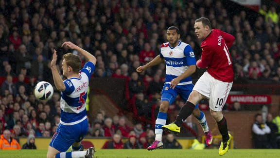 Wayne Rooney scores for a lacklustre Manchester United in their Premier League victoryagainst Reading