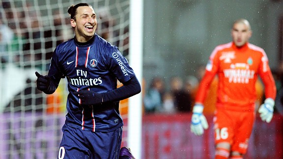 Zlatan Ibrahimovic celebrates after his chipped penalty put PSG two up at St Etienne