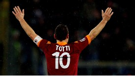 Roma's Francesco Totti salutes his fans after his latest goal for the club, against Parma