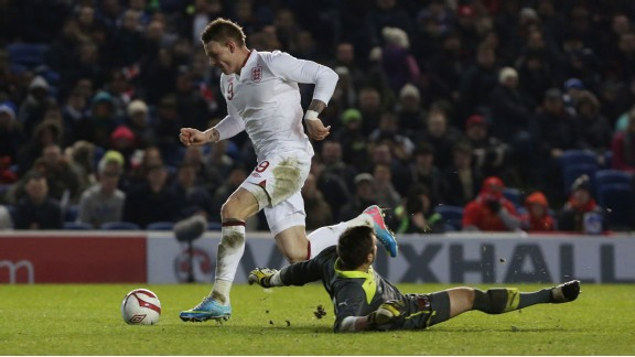 Connor Wickham rounds the Austrian goalkeeper to seal England's 4-0 win