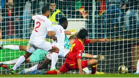 Dejan Damjanovic bundles the ball home to give Montenegro a crucial 1-1 draw with England