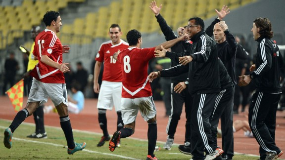 Egypt moved five points clear atop Group G with a late 2-1 win over Zimbabwe