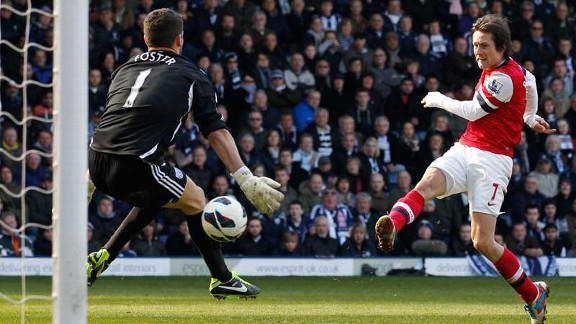 Tomas Rosicky fires home his second goal of the game