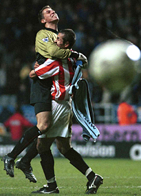 Thomas Sorensen and Emmerson Thome celebrate victory over Newcastle