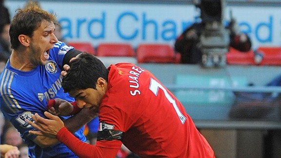 Luis Suarez sinks his teeth into Branislav Ivanovic