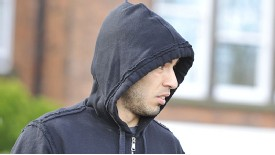 Luis Suarez attempts to keep a low profile on Monday as the biting storm rages on