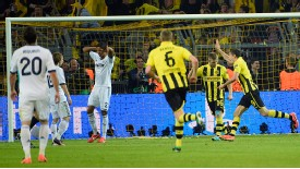 Real Madrid stand dejected as Lewandowski celebrates another goal
