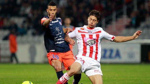 Montpellier's Moroccan midfielder Younes Belhanda vies with Ajaccio's French midfielder Paul Lasne