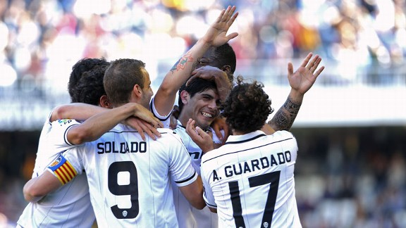 Ever Banega celebrates after netting Valencia's third in their 4-0 thrashing of Osasuna