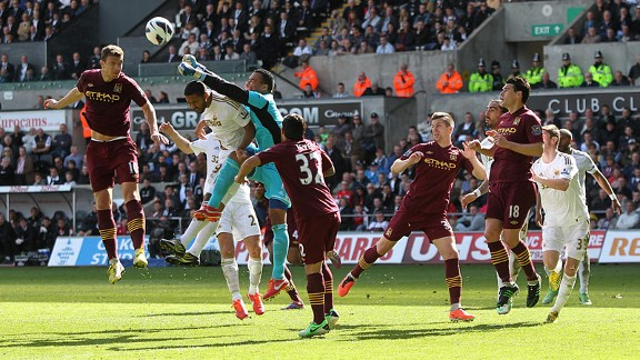 Swansea goalkeeper Michel Vorm punches clear
