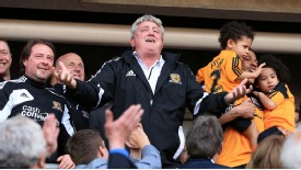 Hull boss Steve Bruce celebrates promotion from the stands at the KC Stadium