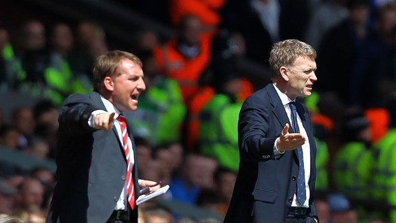 Liverpool manager Brendan Rodgers and Everton boss David Moyes during the Merseyside derby at Anfield
