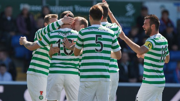 Celtic players celebrate their goal during the 1-1 draw at Ross
