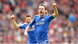 Juan Mata celebrates after firing home Chelsea's late winner at Manchester United