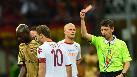 Francesco Totti receives a red card during the 0-0 draw with Milan