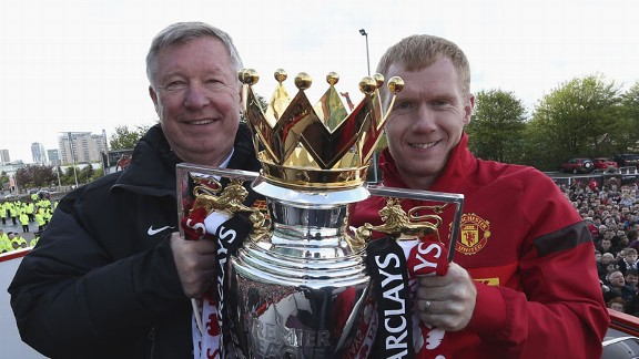 Sir Alex Ferguson parades the Premier League trophy with Paul Scholes