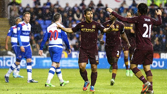 Manchester City celebrate after Sergio Aguero put the managerless side in front at Reading