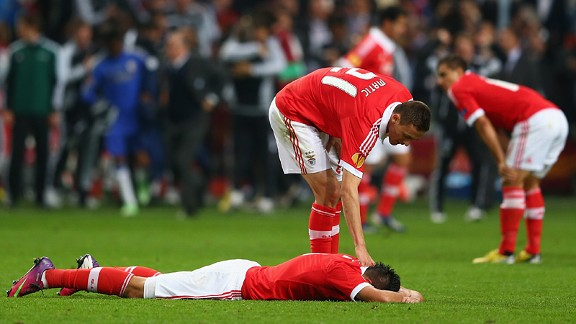 Nemanja Matic of Benfica consoles a dejected Oscar Cardozo after defeat in the Europa League Final against Chelsea in Amsterdam