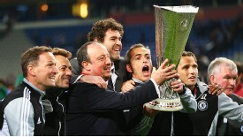 Rafael Benitez and and the Chelsea coaching staff celebrate with Europa League trophy