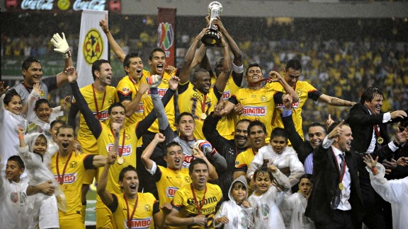 Players of Club America hold the Mexican Clausura Tournament trophy