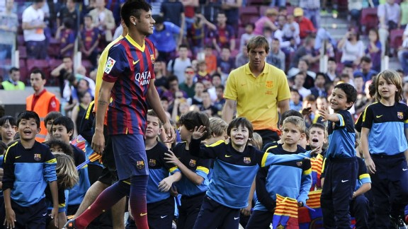 Neymar proved a hit with the kids at his Barcelona unveiling