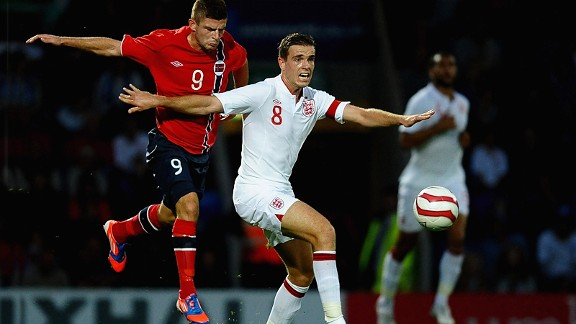 Valon Berisha, one of the most exciting prospects in Norway, battles with England's Jordan Henderson.