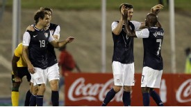 Brad Evans is congratulated by team-mates after scoring against Jamaica