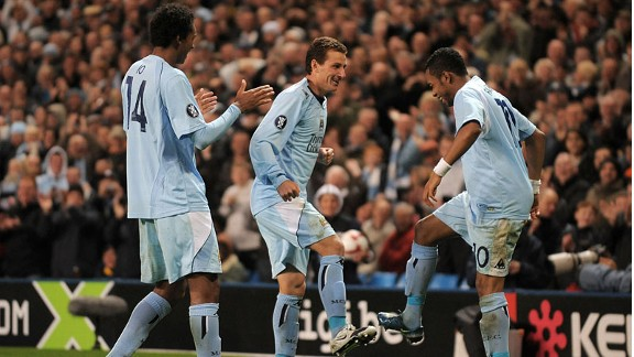 Brazilian trio Jo, Elano and Robinho celebrate a goal for Man City in 2008
