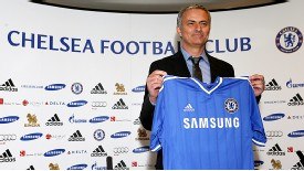 Jose Mourinho poses for the cameras on his return to Chelsea