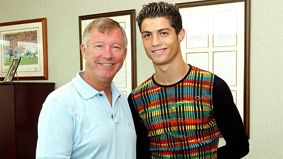 Cristiano Ronaldo with Sir Alex Ferguson on the day he signed for Manchester United