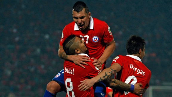 Chile players celebrate a goal against Bolivia.