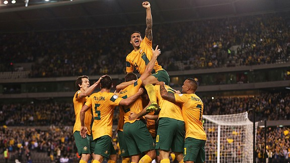 Australia celebrate during their crucial win over Jordan