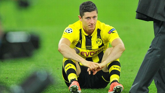 Robert Lewandowski is left to contemplate Dortmund's Champions League loss to Bayern