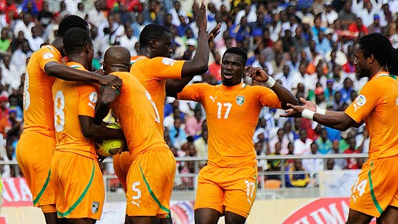 Ivory Coast celebrate one of their four goals against Tanzania