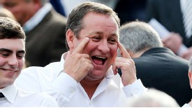 Newcastle owner Mike Ashley smile