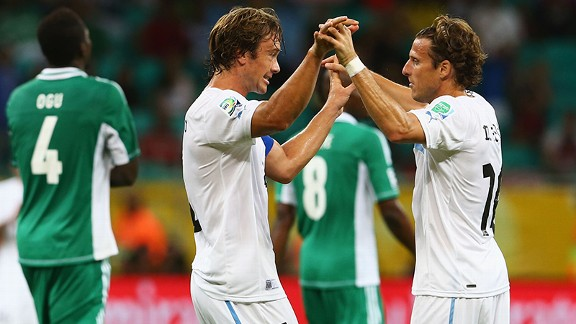 Diego Forlan marked his 100th cap for Uruguay with the winner against Nigeria