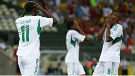 Nigeria players rue one of many missed chances against Spain