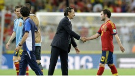 Defeated Italy coach Cesare Prandelli congratulates Spanish players after the game.