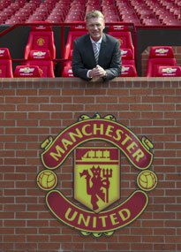 David Moyes poses at Old Trafford after being unveiled as Manchester United manager.
