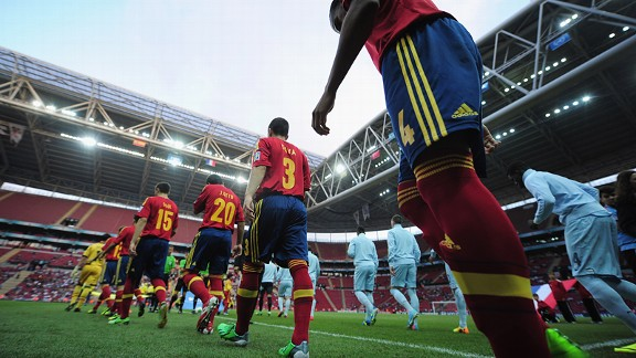 Spain and France walk out in front of a smattering of fans at the Ali Sami Yen Arena during the U20- World Cup.