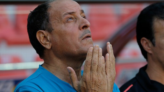 Iraq's head coach Hakeem Shaker prays before the Under-20 World Cup quarter-final match against South Korea.