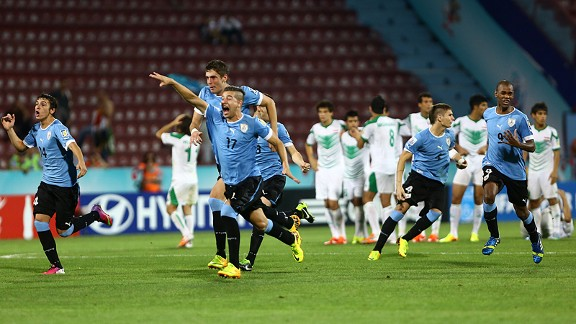 Uruguay's players celebrate their victory over Iraq in the penalty shootout of their Under-20 World Cup semifinal.