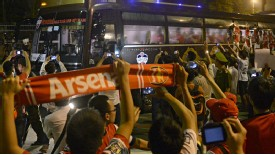 Vietnamese football fans cheer Arsenal players on their VIP bus.